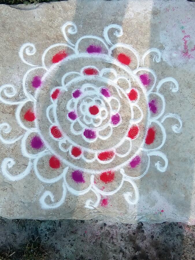 Rangoli design photo in India. Hand made Rangoli design using rangoli powder and Rangoli  colours in Maharashtra, India royalty free stock photography