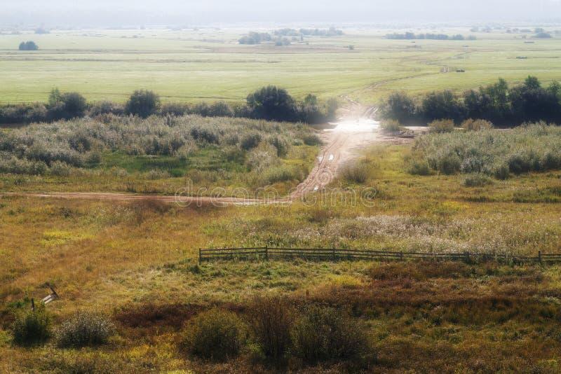 Ranku wiejski krajobraz z drogą fotografia stock