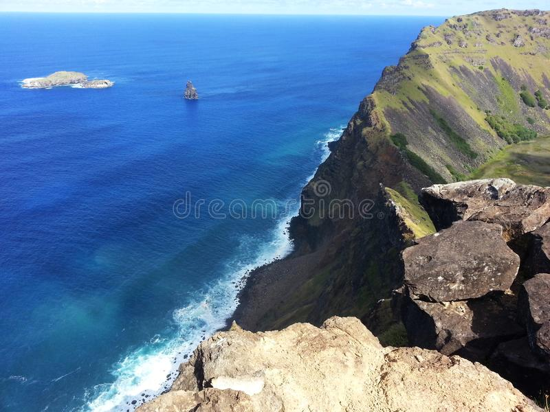 Rano Kau edge. South America travel, Easter Island, Rapa Nui. Special view of Rano Kau crater and the Birdman islands, amazing nature and ocean stock photography