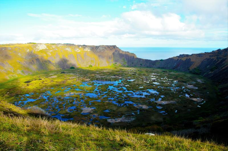 Rano Kau. Long shot of Rano Kau a large volcanic crater containing a freshwater lake in Easter Island, Rapa Nui, Chile, South America stock photos