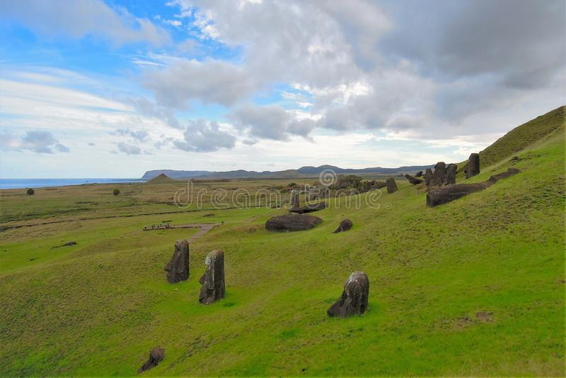 Rano Raraku volcano. Long shot of Moai statues at the famous Moai statue quarry around the Rano Raraku volcano in Easter Island, Rapa Nui, Chile, South America stock photo