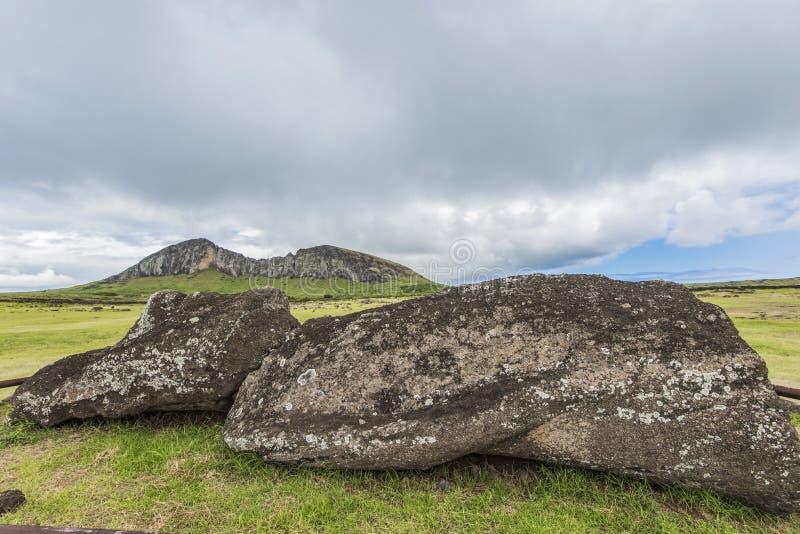 Rano Raraku volcano quarry of the moai and the guardian. A large moai on the front facing the Rano Raraku cradle of all the moai stock photography