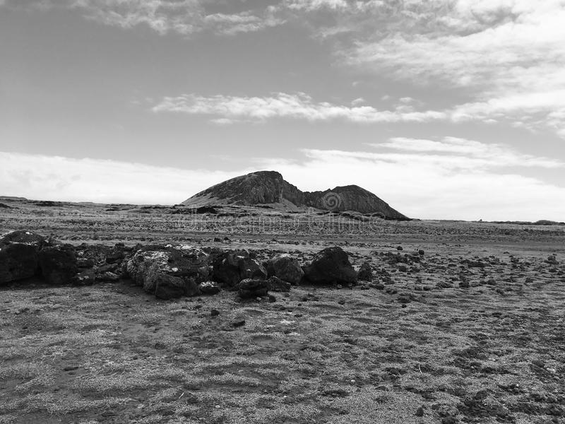 Rano Raraku Vulcano. Moais Factory, Easter Island. Black and White. Sky and Clouds stock images