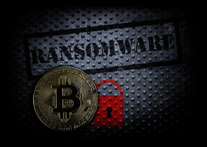 Ransomware and bitcoin. Ransomware text with red lock and a bitcoin stock photography