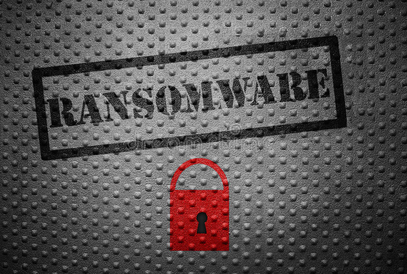Ransomware cybercrime concept. Ransomware stamped on metal with red lock -- cyber crime concept royalty free stock image