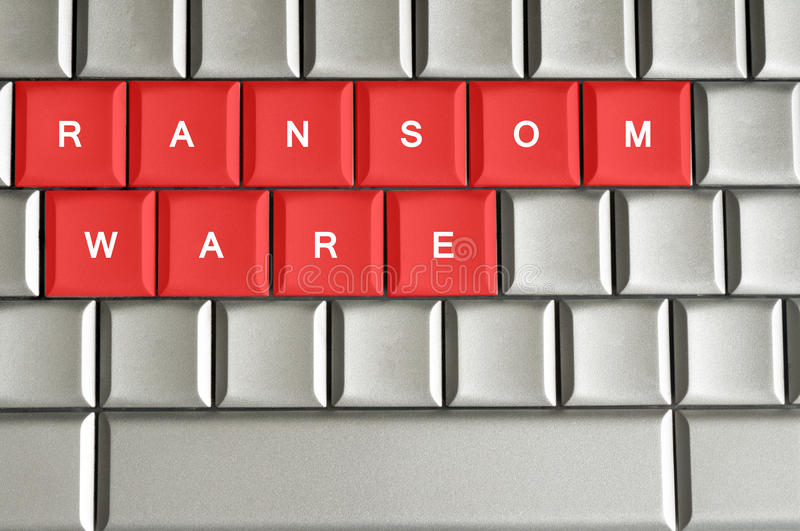 Ransomware written on metallic keyboard. In red stock image