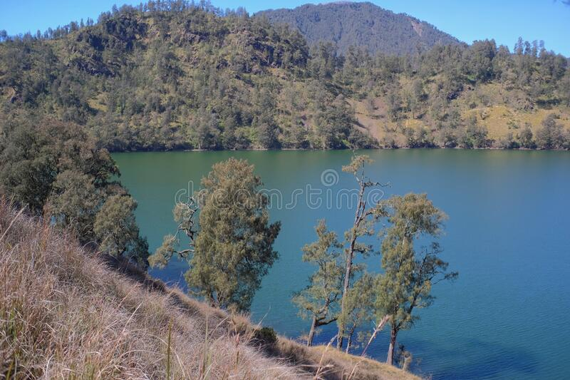Ranu Kumbolo, a lake located within the Bromo, Tengger, Semeru National Park. The lake which is abundant in clean water is a camping spot for climbers who head stock photo