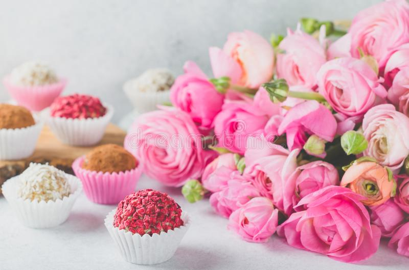 Ranunculus bouquet and homemade balls stock images