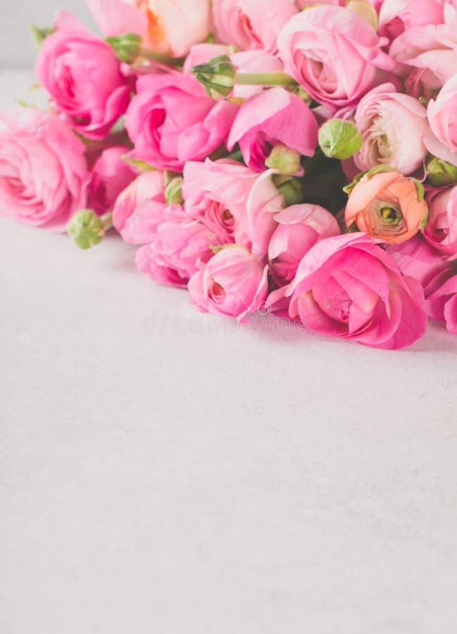 Ranunculus bouquet lying on a light table stock photos