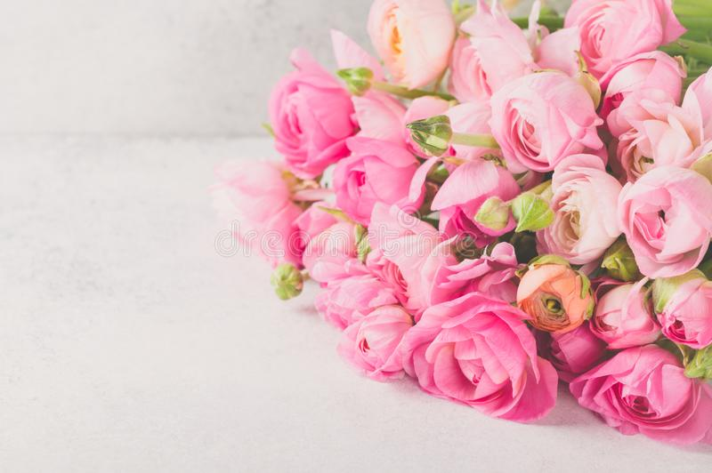 Ranunculus bouquet lying on a light table stock images