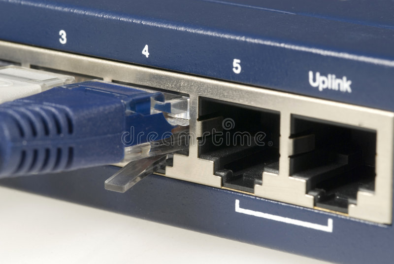 Ranurador y cable de Ethernet imágenes de archivo libres de regalías