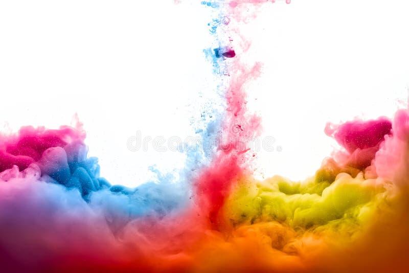 Raoinbow de la tinta de acrílico en agua Explosión del color foto de archivo libre de regalías