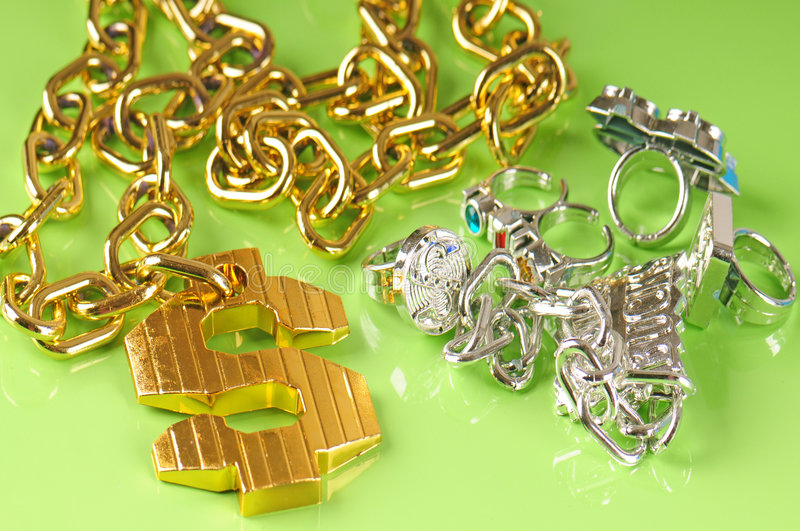 Rap jewelry. Gangster rapper gawdy costume jewerly royalty free stock image