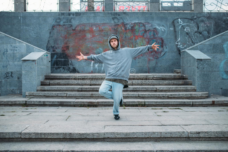 Rap performer posing on the steps, street dancing. Modern urban dance style. Male dancer royalty free stock images