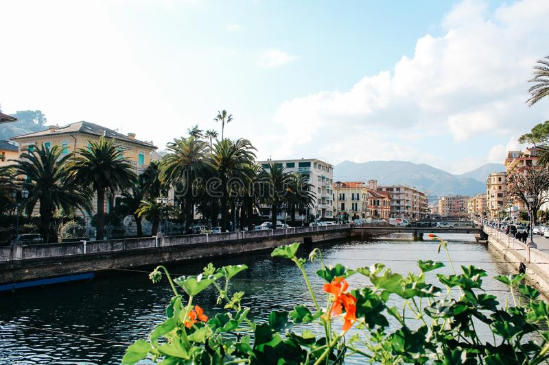 Rapallo, Italy - 03 27 2013: View of the streets of a resort town Rapallo. Rapallo, Italy - 03 27 2013: flowers by the river Boate. View of the streets of royalty free stock photography