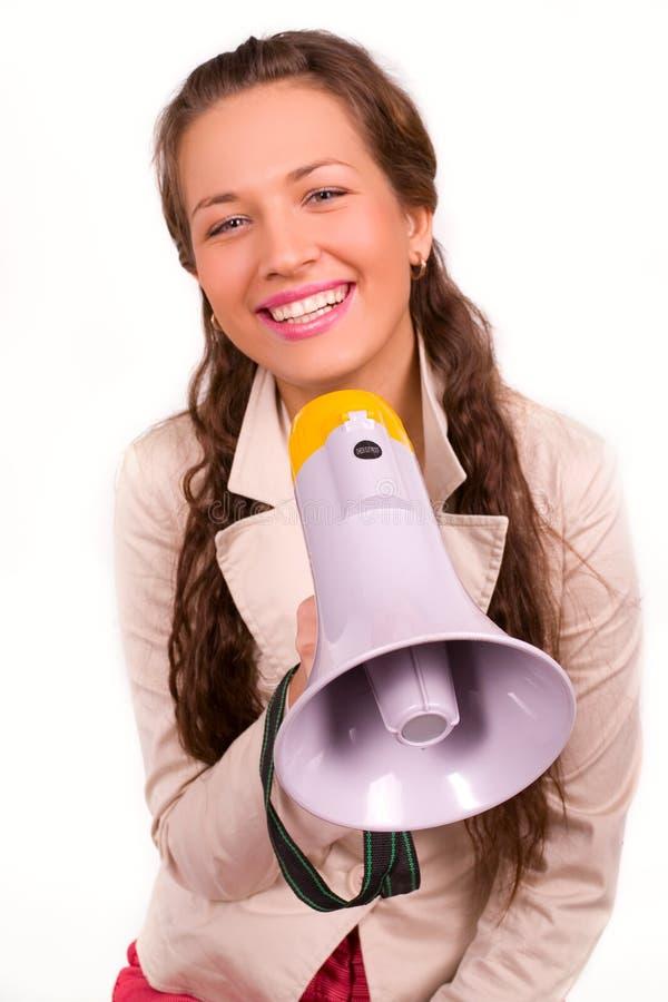 Rapariga bonita com o megafone sobre o branco imagens de stock royalty free