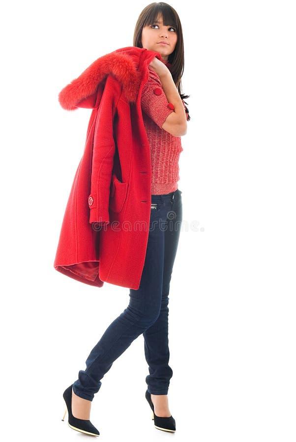 A rapariga bonita com revestimento vermelho foto de stock royalty free