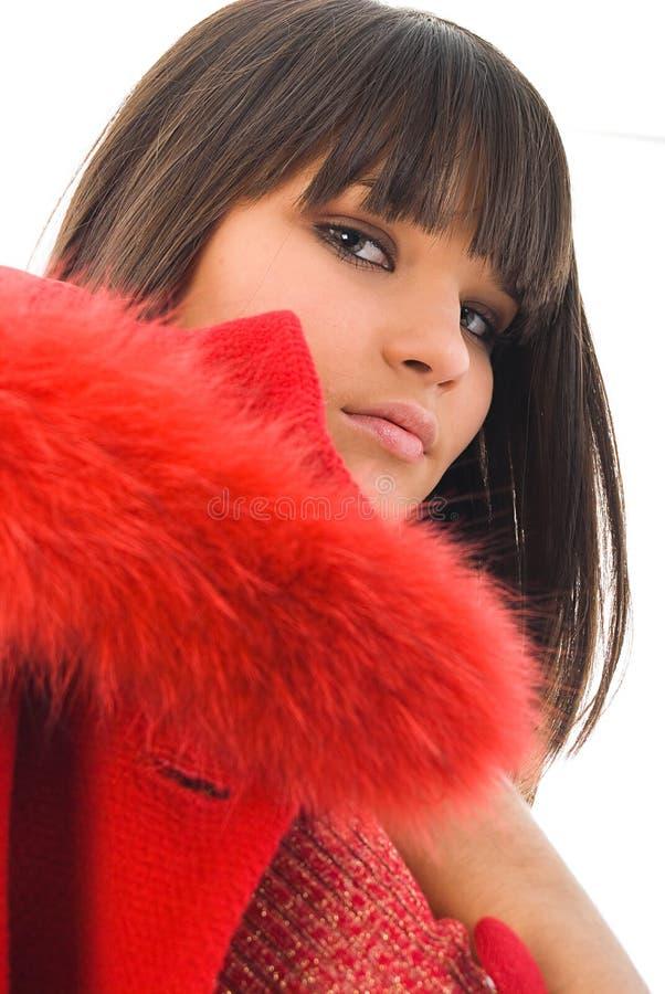 Rapariga bonita com revestimento vermelho imagem de stock royalty free