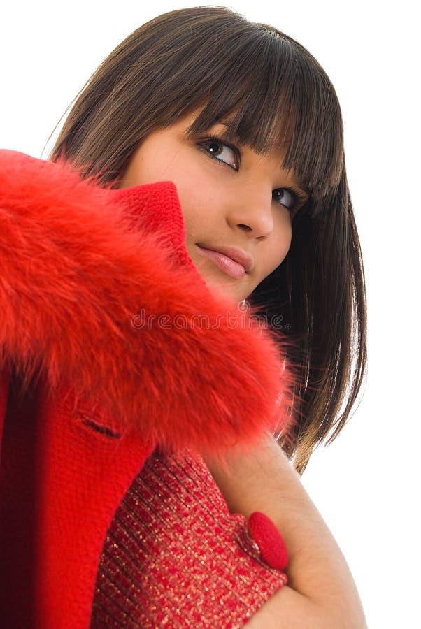 Rapariga bonita com revestimento vermelho imagem de stock