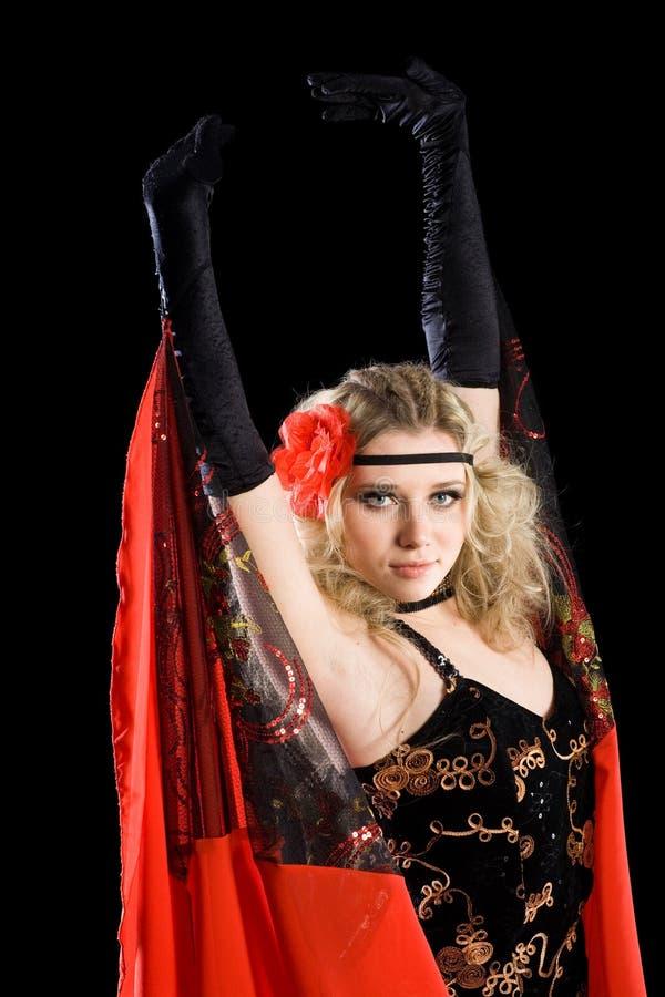 Rapariga que dança a dança clássica do espanhol. imagens de stock