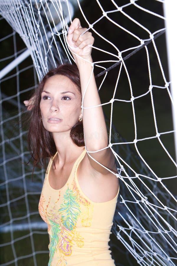 Rapariga bonita no campo de futebol fotografia de stock royalty free