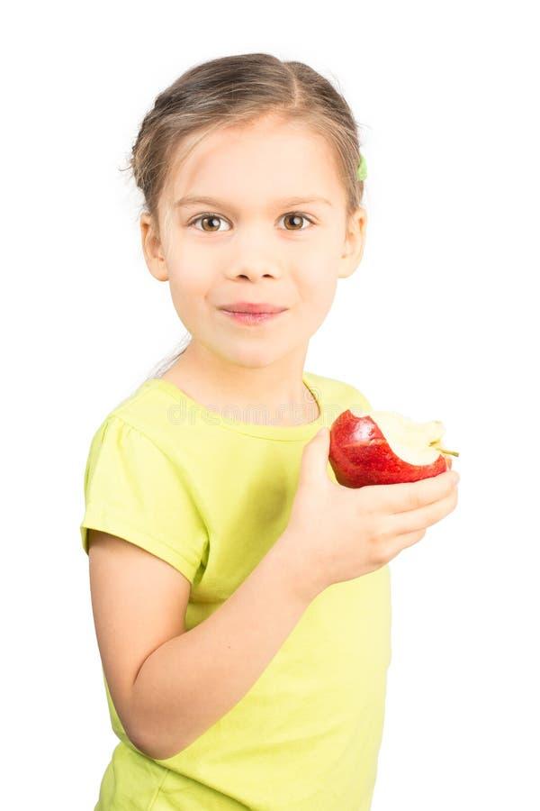 Rapariga que come Apple foto de stock