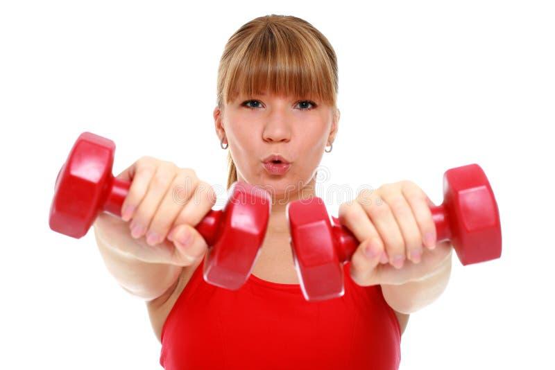Rapariga bonita que faz exercícios da aptidão. foto de stock