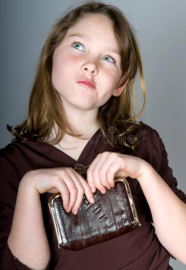 Rapariga com bolsa da mudança imagem de stock royalty free