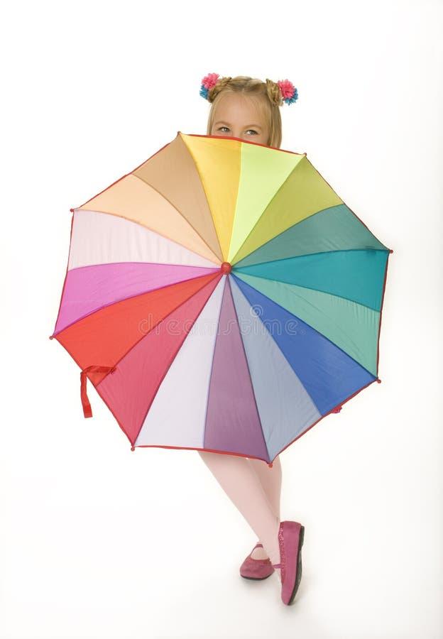 Rapariga com guarda-chuva colorido imagens de stock