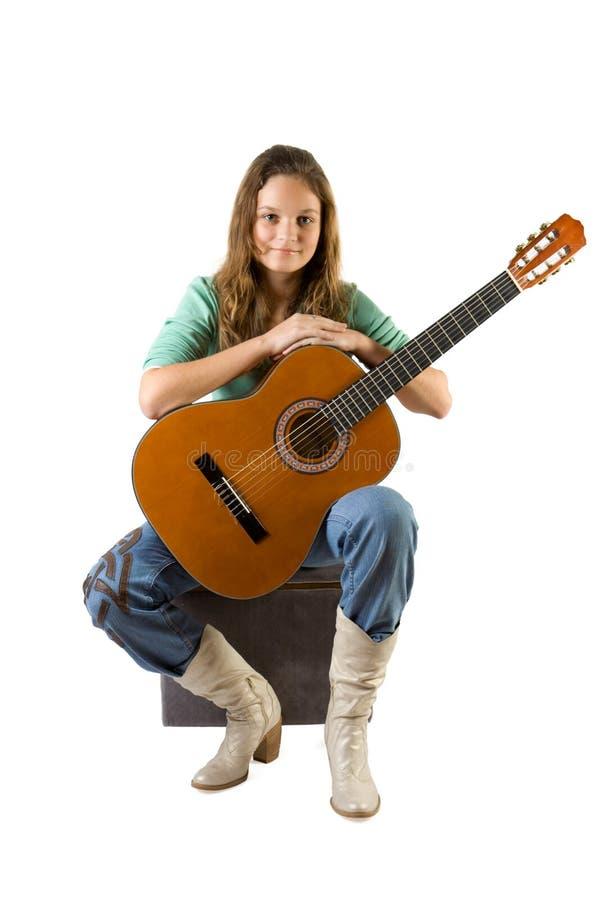 Rapariga com guitarra. imagens de stock royalty free