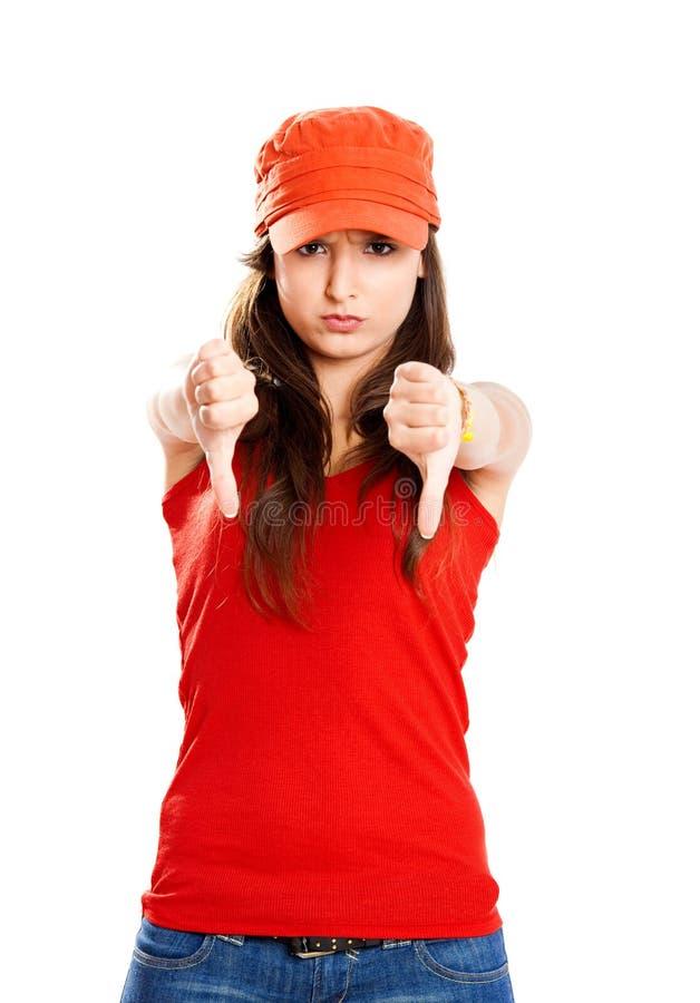 Rapariga com polegares para baixo foto de stock
