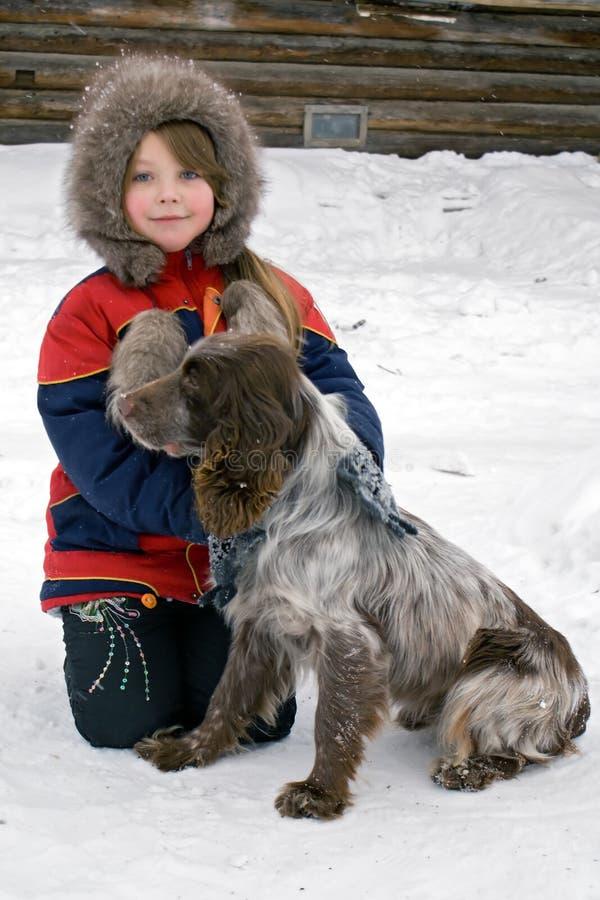 A rapariga com um cão imagens de stock