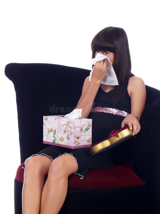 Rapariga com uma mágoa fotografia de stock royalty free