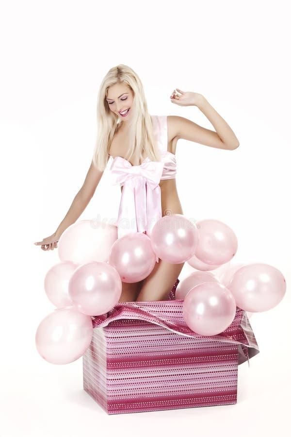 Download Rapariga Como Um Presente Nos Balões Imagem de Stock - Imagem de glamour, colorido: 16850107