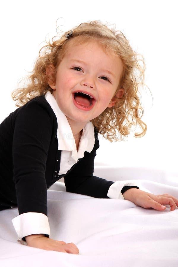Rapariga de riso bonita foto de stock