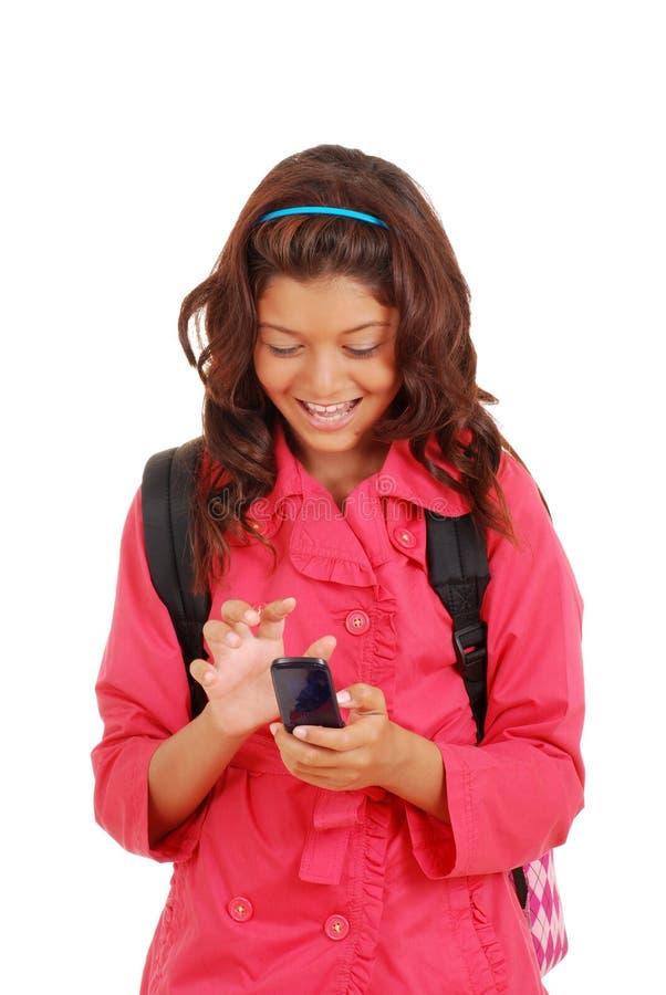 Rapariga de riso com telefone de pilha fotos de stock