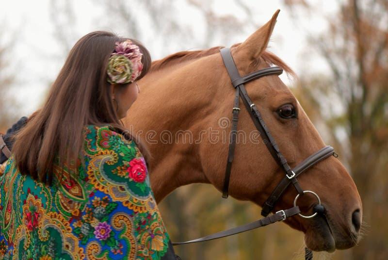 Rapariga e seu cavalo imagens de stock royalty free