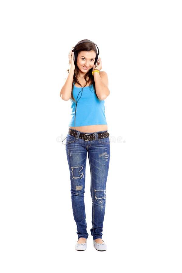 A rapariga escuta música fotos de stock royalty free