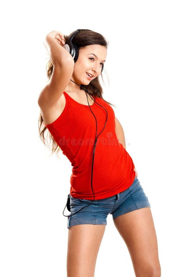 A rapariga escuta música imagens de stock royalty free