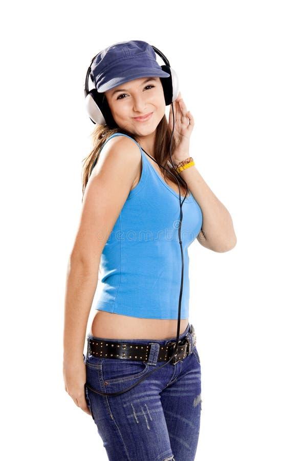A rapariga escuta música imagem de stock royalty free