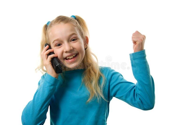 A rapariga está feliz no telefone foto de stock royalty free