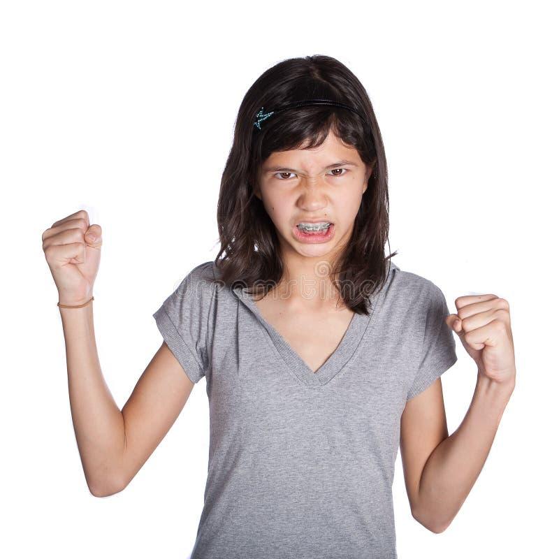 Rapariga irritada com o punho no ar imagem de stock royalty free