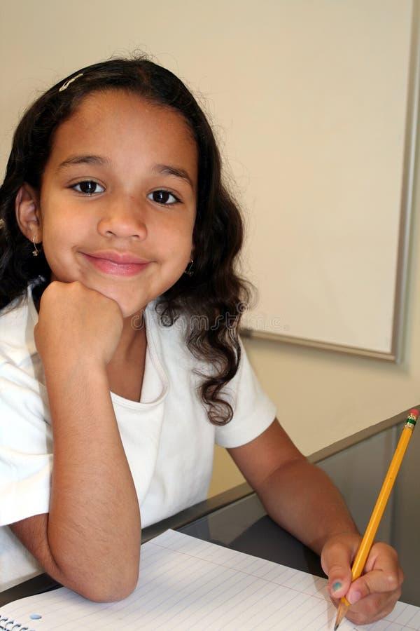 Rapariga na escola imagem de stock