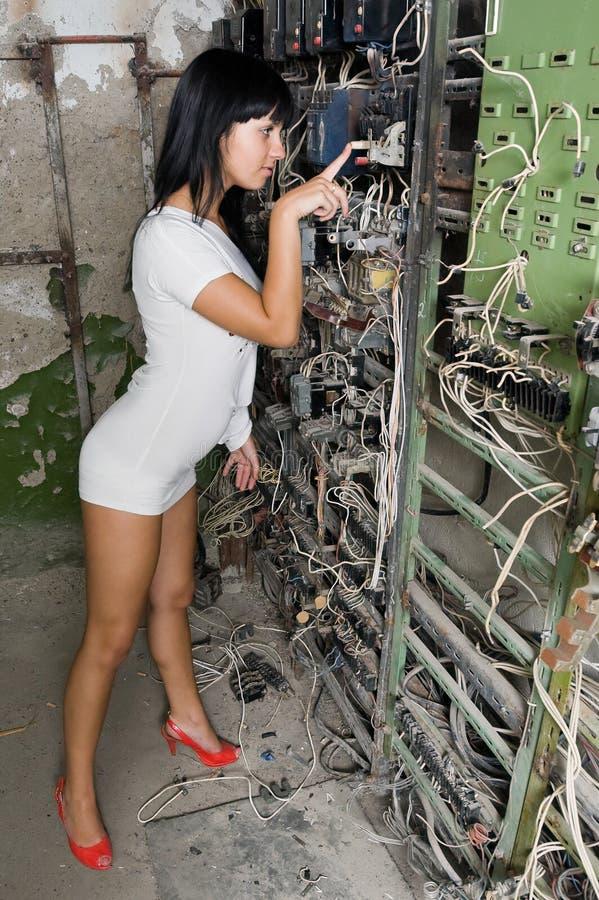 A rapariga na fábrica velha foto de stock