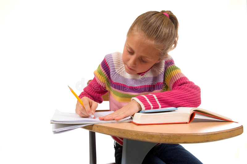 Rapariga na mesa na escola no branco imagens de stock royalty free