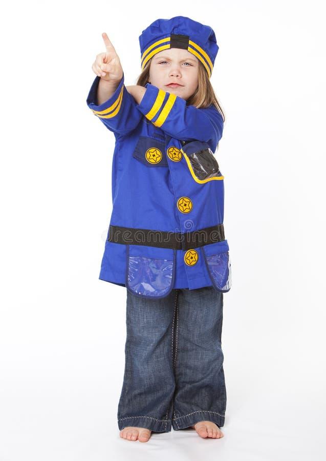 Rapariga no traje da polícia foto de stock royalty free