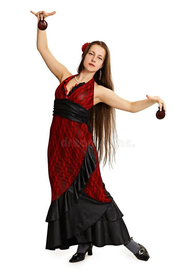 A rapariga no vestido vermelho executa a dança do espanhol imagens de stock royalty free