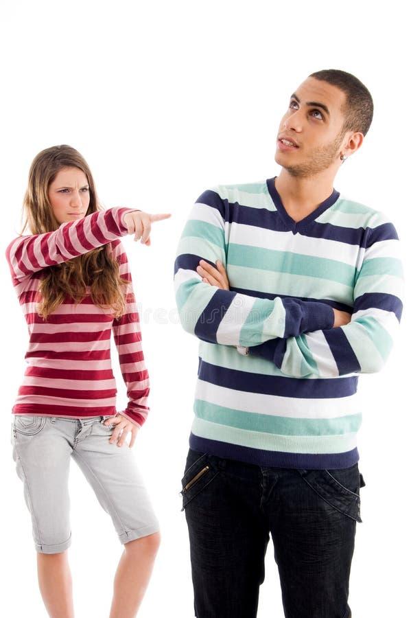 Rapariga que aponta ao menino imagens de stock
