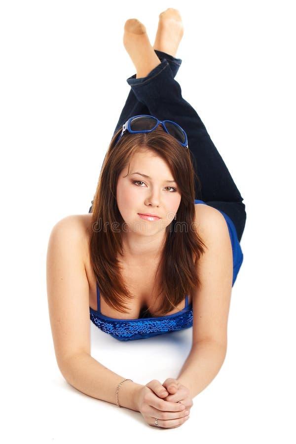 Download Rapariga Que Coloca Em Um Assoalho Foto de Stock - Imagem de caucasiano, colocar: 10064564