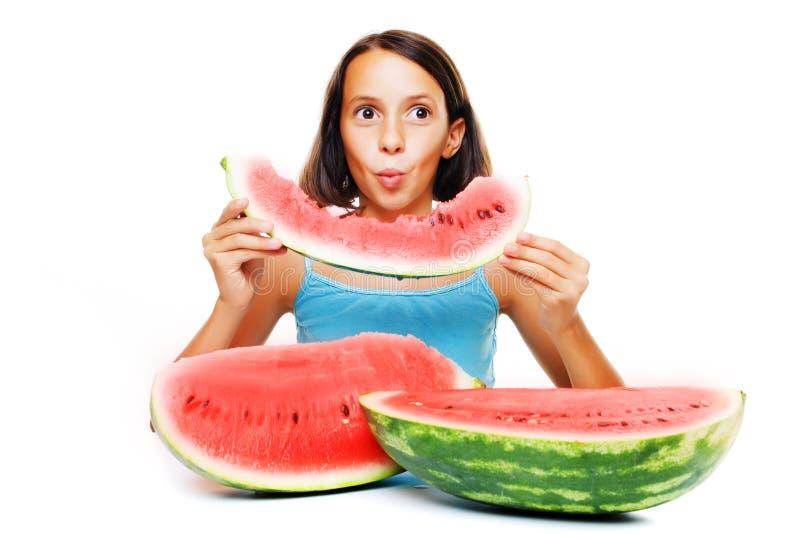 Rapariga que come o melão de água imagens de stock royalty free